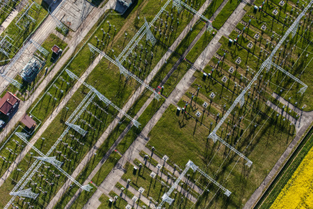 insulators: Aerial image of electrical substation featuring wires, transformers and large scale power energy towers in Poland