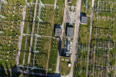 amperage: Aerial image of electrical substation featuring wires transformers and large scale power energy towers in Poland Stock Photo