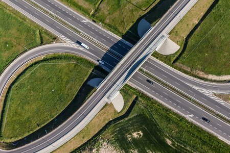highway: aerial view of highway and green harvest fields in Poland Stock Photo