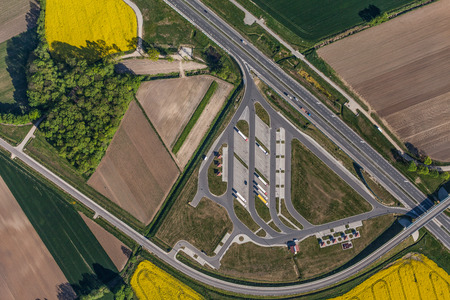 birds eye view: aerial view of highway and green harvest fields in Poland Stock Photo