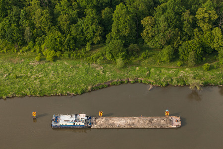 towed: aerial view of a river barge in Poland