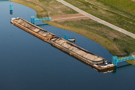 towed: aerial view of a river barge on Odra river in Poland