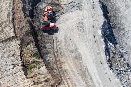 mover: Aerial view of the earth mover and truckin the quarry