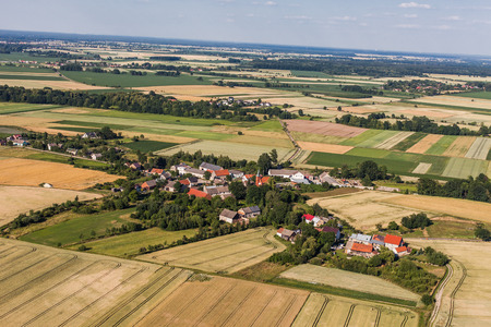 village: aerial view of the blue sky  and village harvest fields in Poland