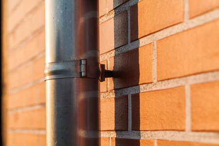 gutter: gutter pipe and brick wall Stock Photo