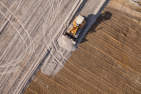 on site: Aerial view of the working earth mover in Poland Stock Photo