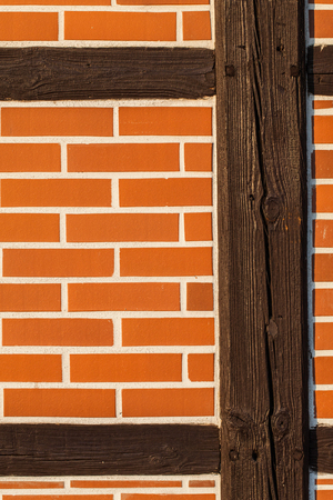 wooden post: Background of renovated brick wall with old wooden post