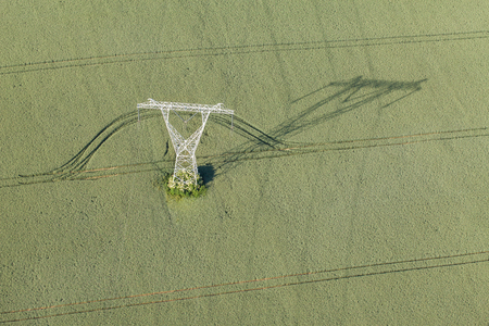 electric grid: Aerial view of electrical wires large scale power energy tower in Poland Stock Photo