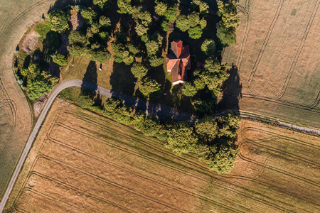 aerial view of the  church and harvest fields in Poland