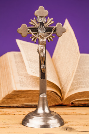 chaplain: crucifix composition on wooden table