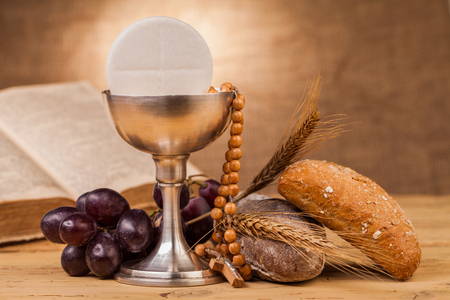 holy communion chalice on wooden table Stok Fotoğraf