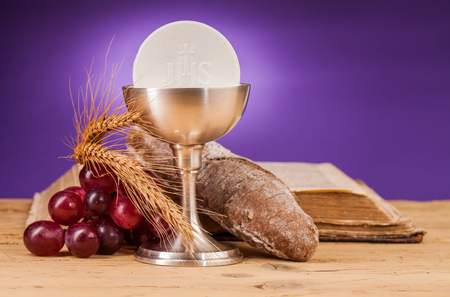 liturgy: holy communion chalice on wooden table Stock Photo