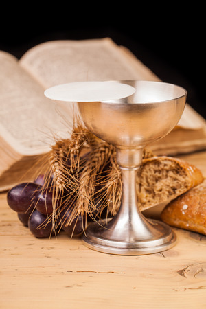 communion wafer: holy communion chalice on wooden table Stock Photo
