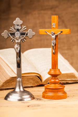 preach: crucifix composition on wooden table