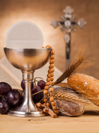 catholic mass: holy communion chalice on wooden table Stock Photo