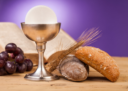 holy cross: holy communion on wooden table Stock Photo