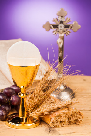 chaplain: holy communion chalice on wooden table Stock Photo