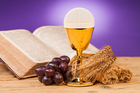 preach: holy communion chalice on wooden table Stock Photo
