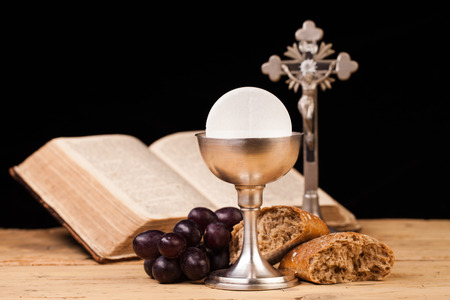 holy eucharist: holy communion on wooden table Stock Photo