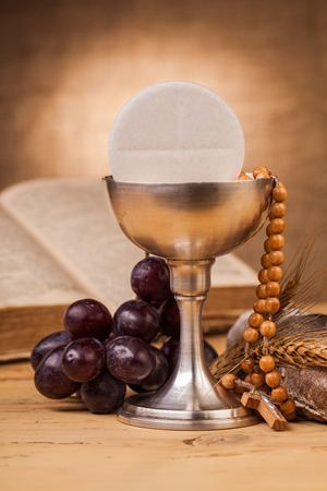 chalice: holy communion chalice on wooden table Stock Photo