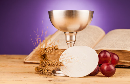 communion wafer: holy communion  on wooden table