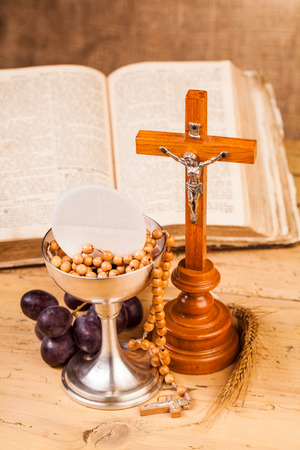 holy communion chalice on wooden table Stock Photo