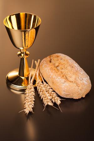 chaplain: Christian holy communion on dark surface