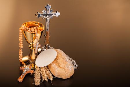 communion wafer: Christian holy communion on dark surface