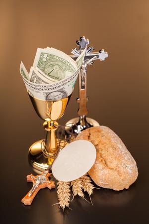 communion wafer: Christian holy communion and dollar money Stock Photo