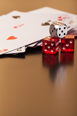 money risk: set of playing card with dices on reflective table