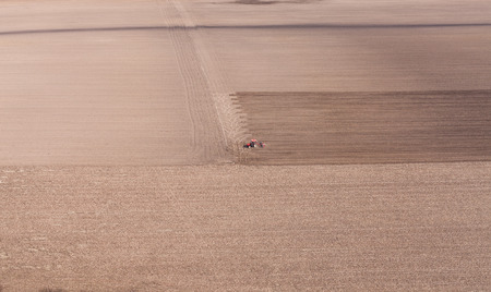 vogelspuren: aerial view of  tractor on harvest field in Poland