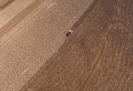 line of people: aerial view of  over the tractor on  harvest field in Poland