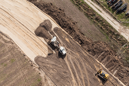 payload: Aerial view of the  track  and earth mover tracks on sand in Poland