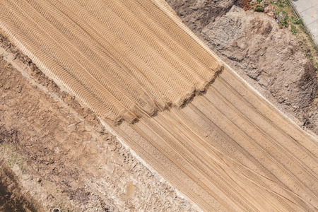 mover: Aerial view of the  earth mover tracks on sand in Poland