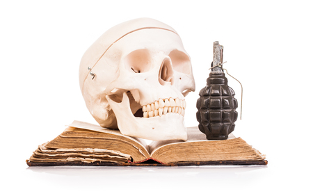 granade: holy book and human scull  isolated on white  background