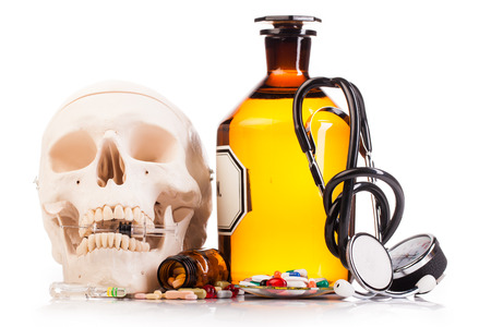ampule: medicines human scull and drugs on table isolated on white