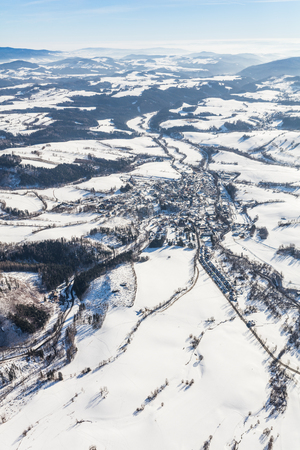 aerial  view of the mountain winter forest in Czech Republic near Stare Mesto pod Sneznikem Town Stock Photo