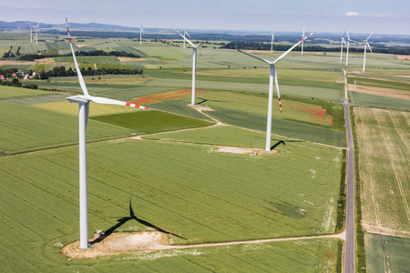 windpower: aerial view of the wind farm and harvest fields near Lasowice  village near Otmuchow town  in Poland