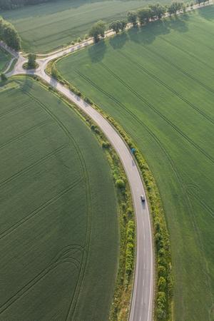 aerial view of the village road in Poland Archivio Fotografico - 103360048