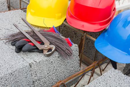 helmets on the building site Archivio Fotografico - 117009548