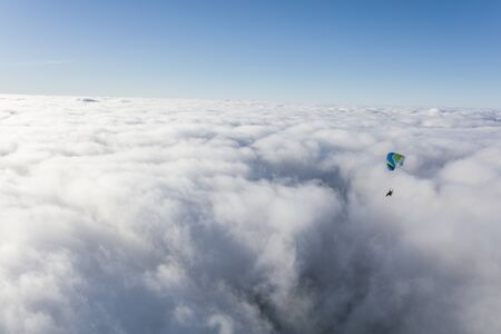 aerial view of the paraglider over the clouds Archivio Fotografico