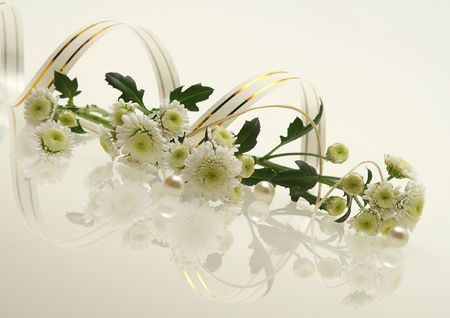 perls: picture with flowers, three perls and reflections Stock Photo