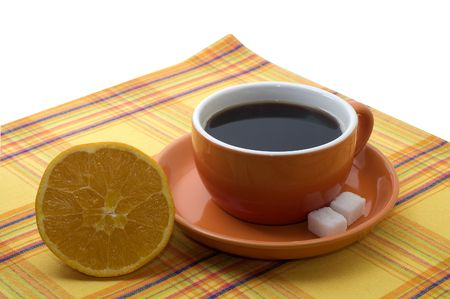 serviette: cup of coffee with an orange on a serviette