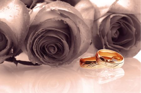 two wedding rings with tree roses as a background rendered