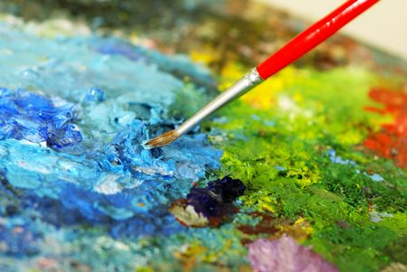 small painbrush is mixing colors on  palette. Shallow DOF Stock Photo - 2743922