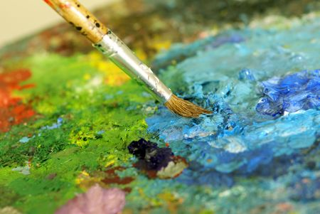 big paintbrush is mixing colors on palette. Shallow DOF Stock Photo - 2744366