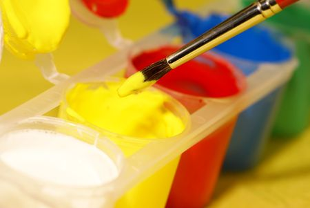 paintbrush diped into the yellow colour of watercolour set. Shallow DOF Stock Photo - 2744362