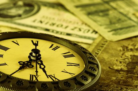 numismatics: concept Time is money stylized as antique . Shallow DOF