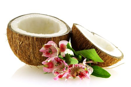 two pieces of ripe coconut with flowers over white background