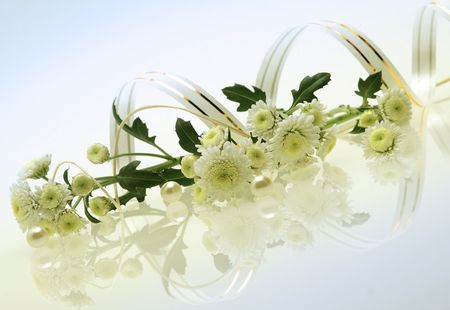 elegant floral composition with chrysanthemums, perl and reflection photo